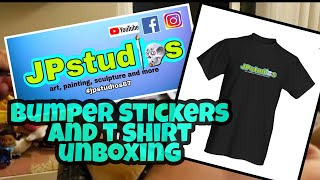 Bumper sticker and T shirt unboxing