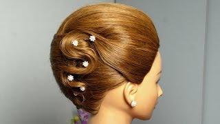 French twist hairstyle for long hair. Elegant updo.