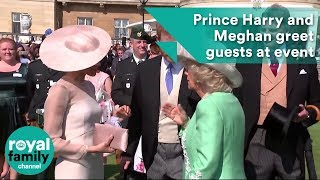 Prince Harry and Meghan greet guests at Prince Charles