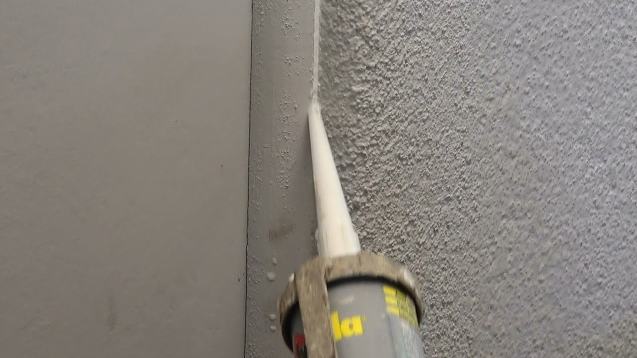 How to caulk how to caulk gaps around window or door for Door gap filler