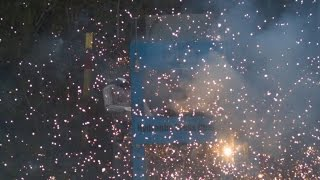 Crushing fireworks with hydraulic press