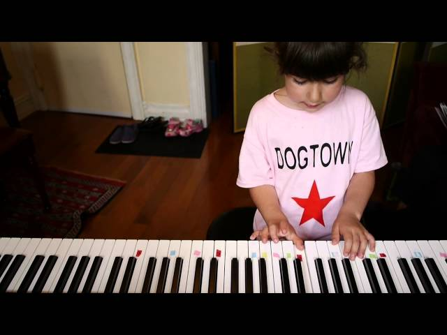 Stella plays Do You Want To Build A Snowman? on piano