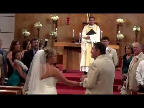 Father sings to daughter as they walk down the aisle...