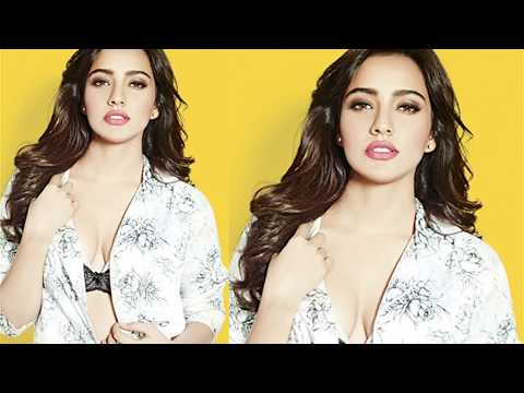 Hot & Sexy Neha Sharma Flaunts Cleavage At Fhm Cover video