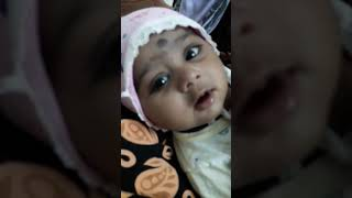 Small baby girl sing a song before a sleep...4 month baby age.