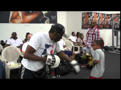 Roger Mayweather padwork w/ little kid- He really hammers the little guy!