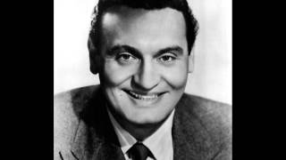 Watch Frankie Laine Rawhide video