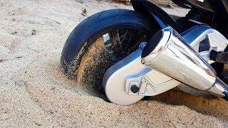The power wheels sport bike stuck in the sand