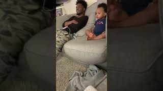 crazy baby talking with his father