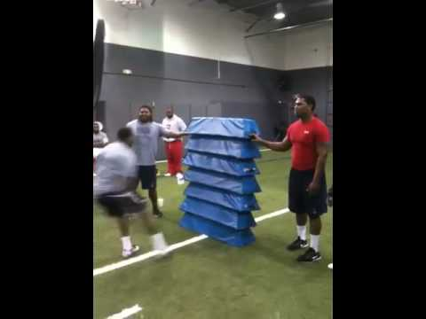 Joe Webb, QB/receiver from UAB, jumps over 7 dummies while training for the NFL combine at CES Performance in Atlanta. CES Performance is dedicated to improving professional and elite amateur...