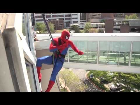 Spiderman Cleaning the Windows at a Children's Hospital