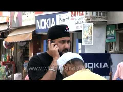 Indian man talking on mobile phone