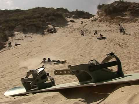 Sandboarding down South Africa's gold mine 'dumps'