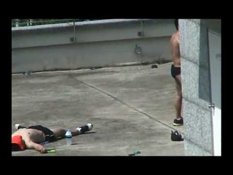 Korean Men Sunbathing (Tanning) on Apartment Rooftop in Yongin, Korea