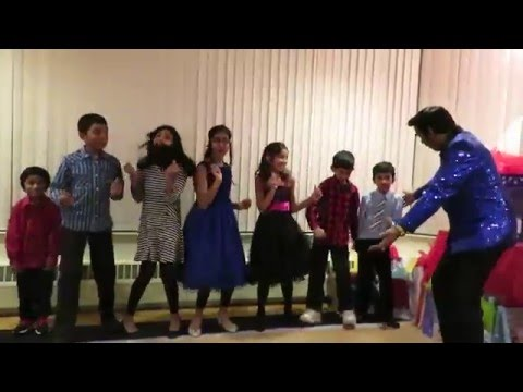 Sri Lankan Canadian Elvis Presley singing Christmas song, Toronto, 2015.