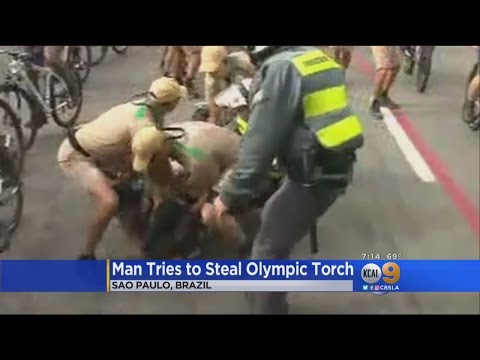 Man Tries -- And Fails -- To Steal Olympic Torch In Sao Paulo