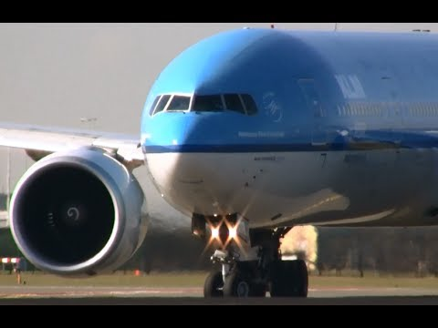 Landing and close-up take-off KLM 777-300 Amsterdam airport Schiphol