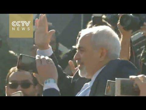 Iranian FM receives hero's welcome in Tehran