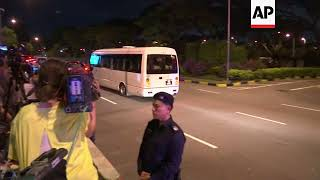 Kim's convoy arrives at Singapore airport as he prepares to return home