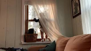 Window, Baby, and a Pile of Laundry
