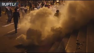 RAW: Protesters against political corruption clash with police in Lima, Peru