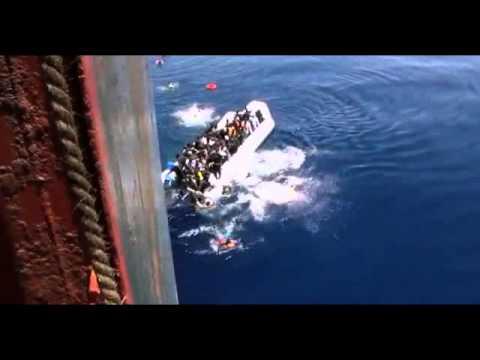Migrants scramble to safety on to cargo ship Zeran   BBC News