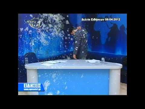 Yogurt attack during live TV News show (Greece)