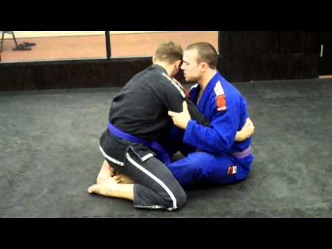 Butterfly Guard Hook Sweep shown by Goodyear BJJ instructor Kevin Scott Image 1