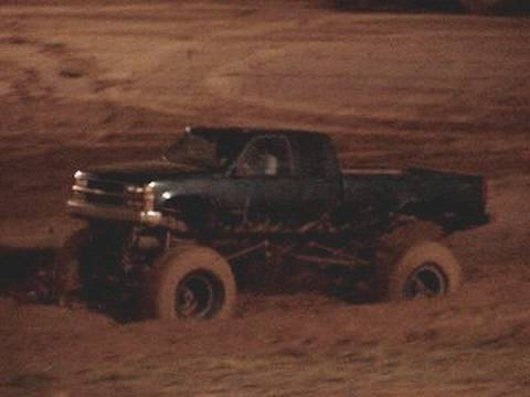 HUGE MUD TRUCK in HD RIPPING THROUGH MUD PIT - Chevrolet Silverado 4x4 Video