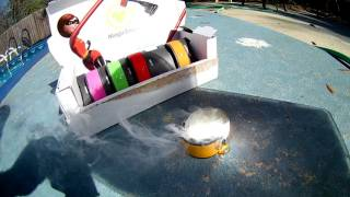 Melting Disney MagicBand with the Sun using a Fresnel lens