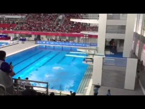Singapore's diving twins Timothy & Mark Lee diving in the 3m synchronised springboard final