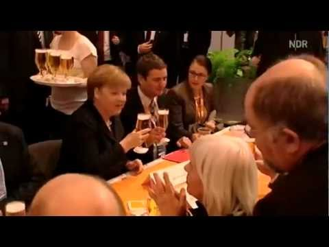 Angela Merkel gets a beer and takes it cool (Funny)