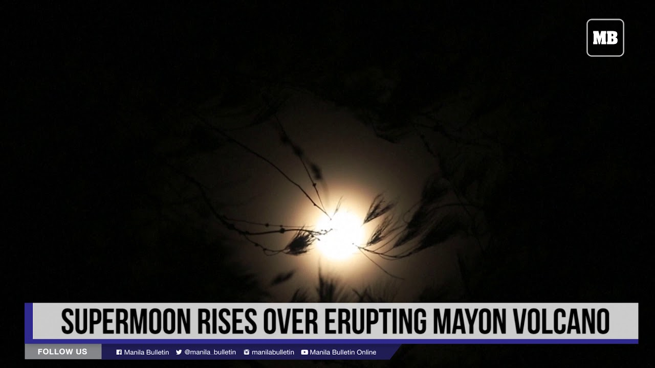 Supermoon rises over erupting Mayon volcano