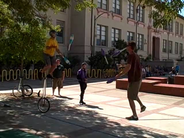 Slackrope and Giraffe Unicycle Club Passing at the 2009 Berkeley and Unicycling Festival