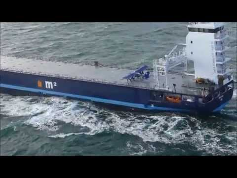 Extreme small plane landing on a ship at sea