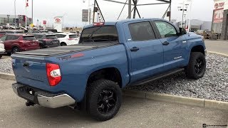 Lifted 2019 Cavalry Blue Toyota Tundra on 305/55R20 Tires