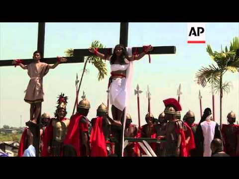 Faithful re-enact the crucifixion of Christ to mark Good Friday