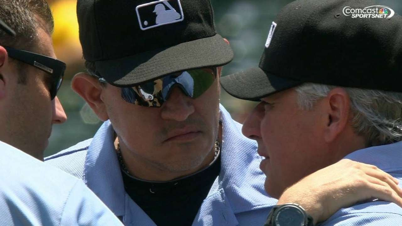 COL@OAK: Home-plate ump takes foul ball to mask