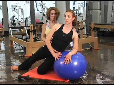 Lawson Harris of The Lab Pilates workout w/physio ball and 5lb weights