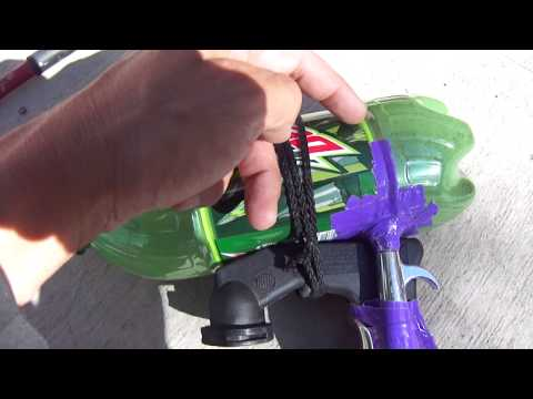 Home made quick and easy mini sand-blaster made out of a mountain-dew bottle and some duck tape..