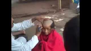 Indian head shave in street