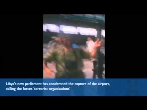 Libya: Islamist-allied fighters celebrate after seizing Tripoli airport - video