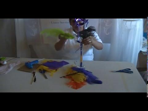 Centro de mesa plumas y mascara