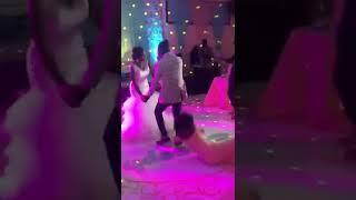A bridesmaid falls as the couple take their dance