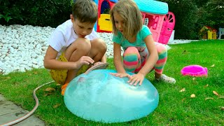Max and Katy playing with outdoor activity toys