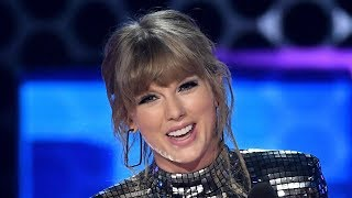 Taylor Swift TEASES #TS7 & Wins Artist of the Year at 2018 AMAs