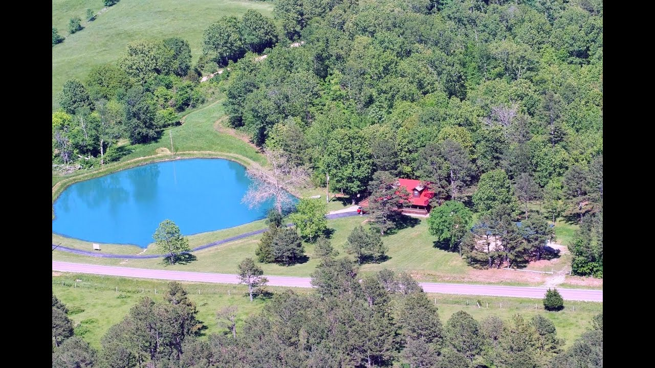 Wake every morning to a beautiful blue spring fed pond for Building a 1 acre pond