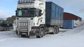 Scania R480 with hook lift,  loading an empty container 2013