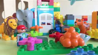 Lego Duplo Animals Gardener plants Flowers Kids are playing