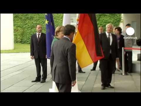 Sarkozy and Merkel reach a deal over Greece